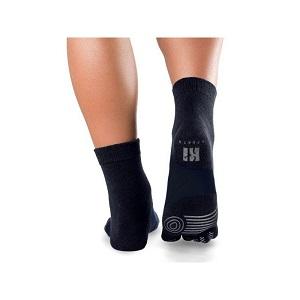 Vous pouvez voir ici le revêtement grippant de ces chaussettes running. © Knitido